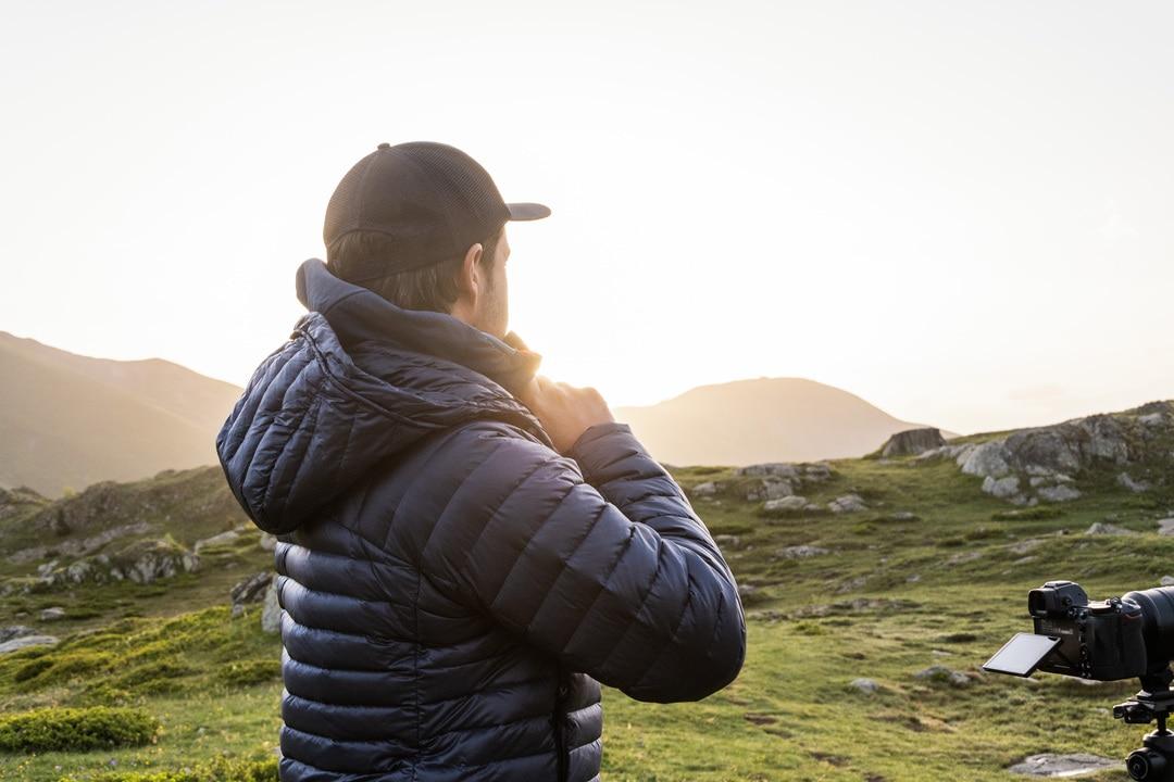 photographe face au soleil levant